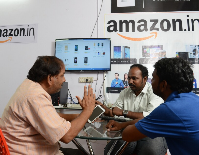An Udaan point with a customer