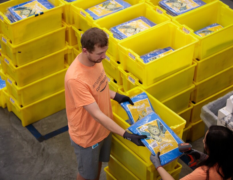 Amazon associates prepare items to distribute in the aftermath of Hurricane Dorian.