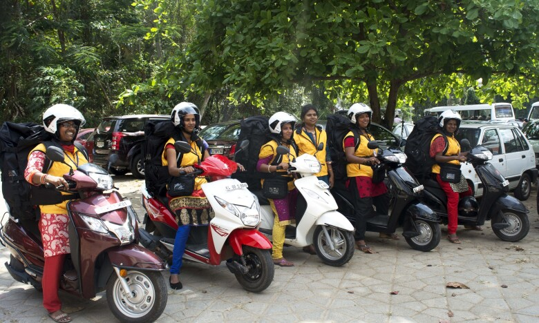 Five women on motor scooters.