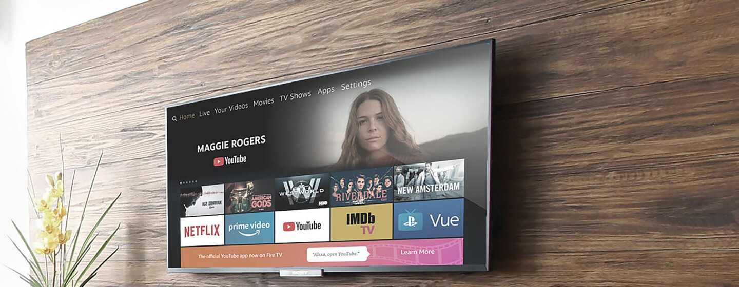A television screen on a living room wall, showing a screen from YouTube on Fire TV.