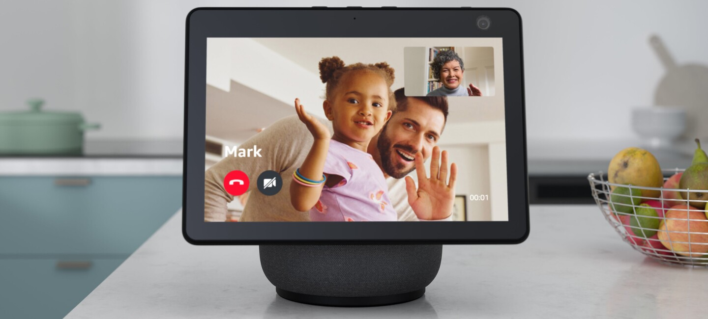 The Amazon Echo Show 10 on a kitchen counter top showing a video call.