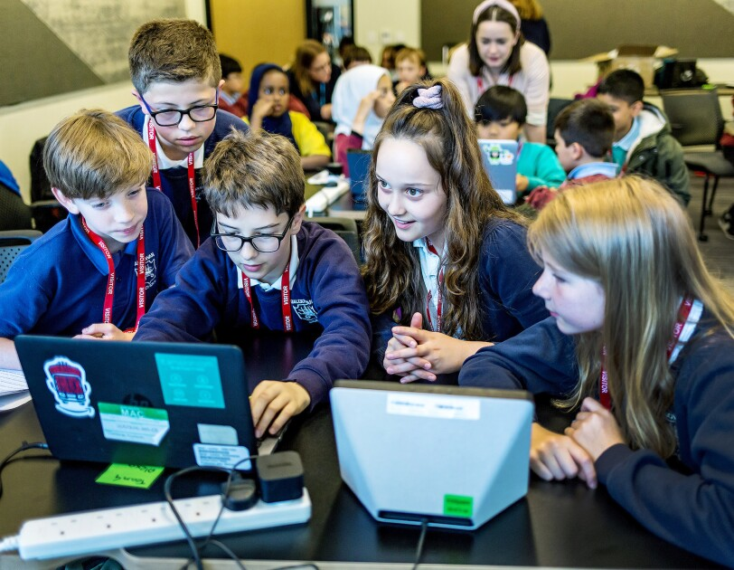 School children learning to code at Amazon UK