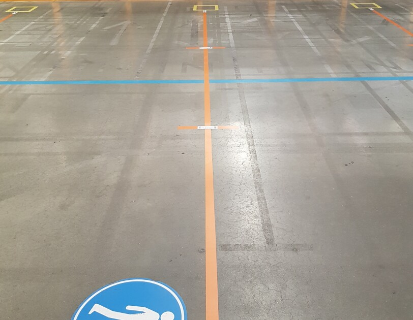 Markings on the floor of fulfilment centre to support social distancing