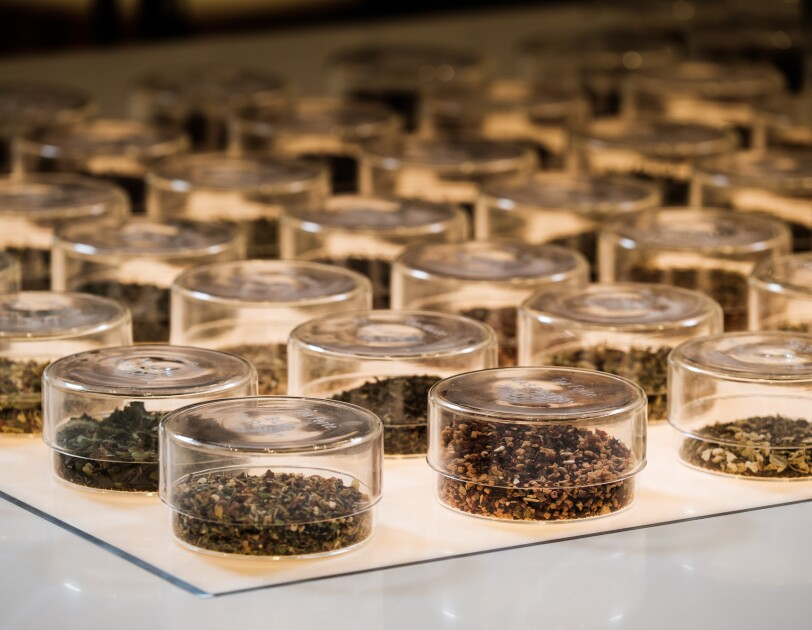 Glass containers filled with loose leaf tea.