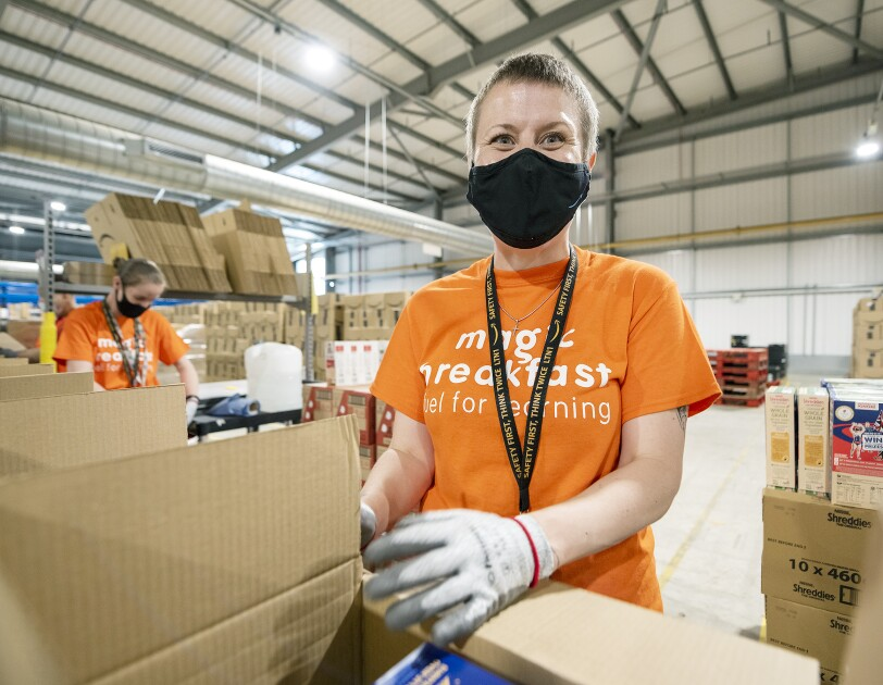 Magic Breakfast Amazon volunteer packing food for school children