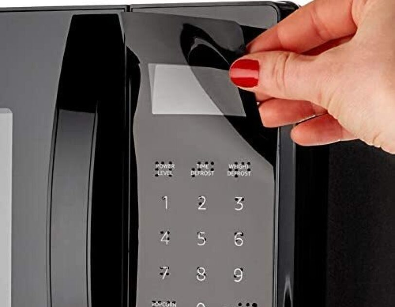 A product image of the braille keypad overlay available for the AmazonBasics microwave.