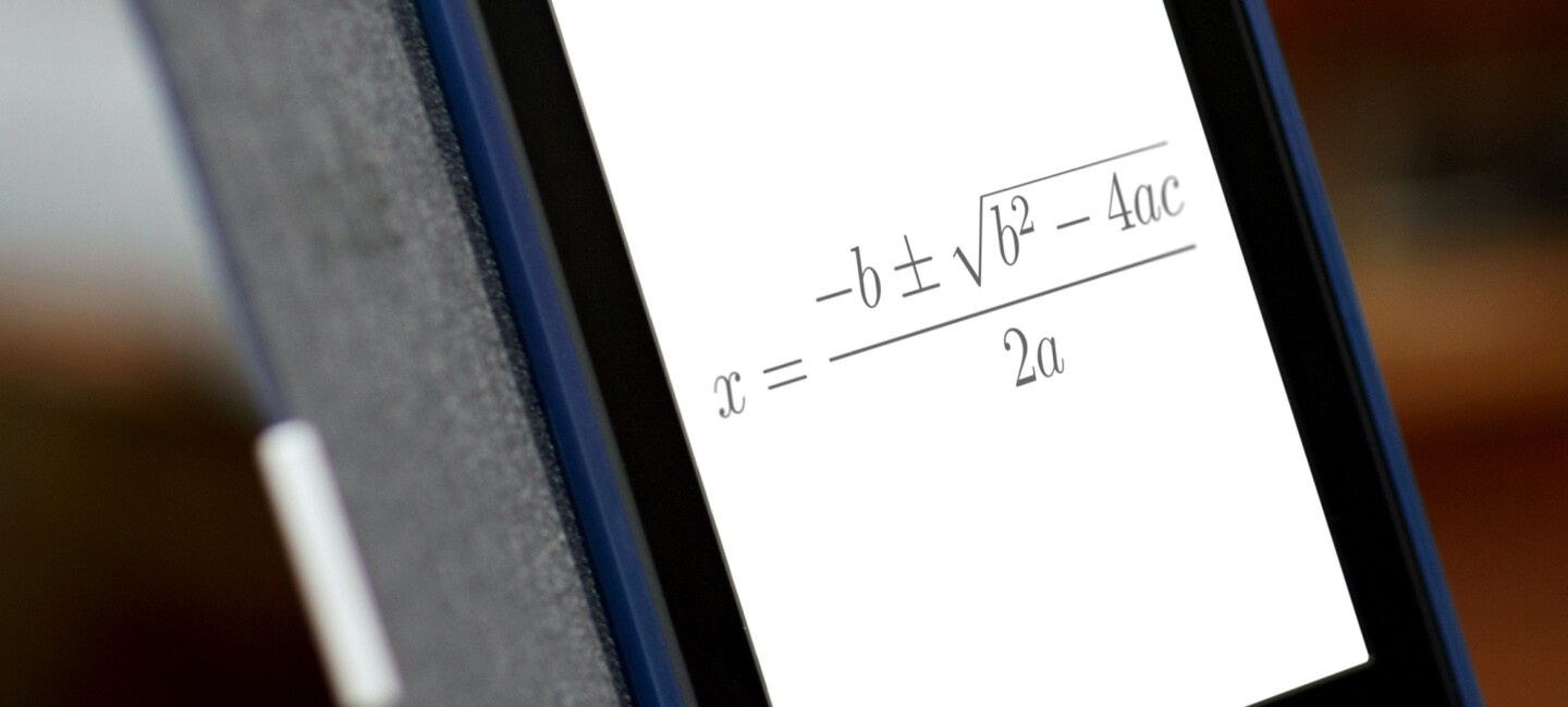 An Amazon Kindle device displays a complex math equation.