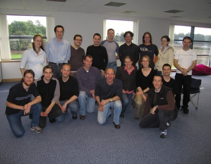 group shot of Jeff Bezos, Matt Round and the rest of the original team. 2004