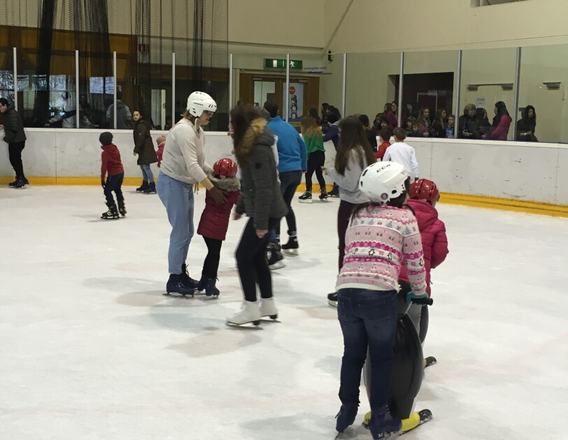 Amazon in the community takes refugees ice skating