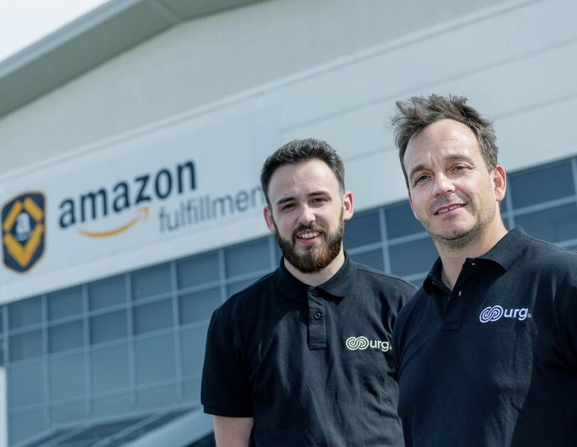 Ryan and Gareth from United Retail Group Ltd pictured outside the Amazon warehouse in Peterborough