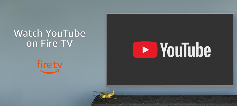 En una pared gris aparece un tlevisor con el logo de YouTube. Debajo del televisor un mueble de color gris más oscuro con una avioneta de color amarillo. En el lado izquierdo de la imagen la frase Watch YouTube on Fire TV.