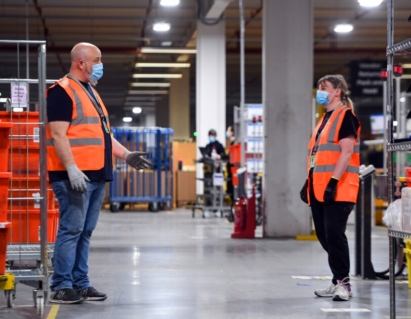 Amazon employees keeping a safe distance form one another