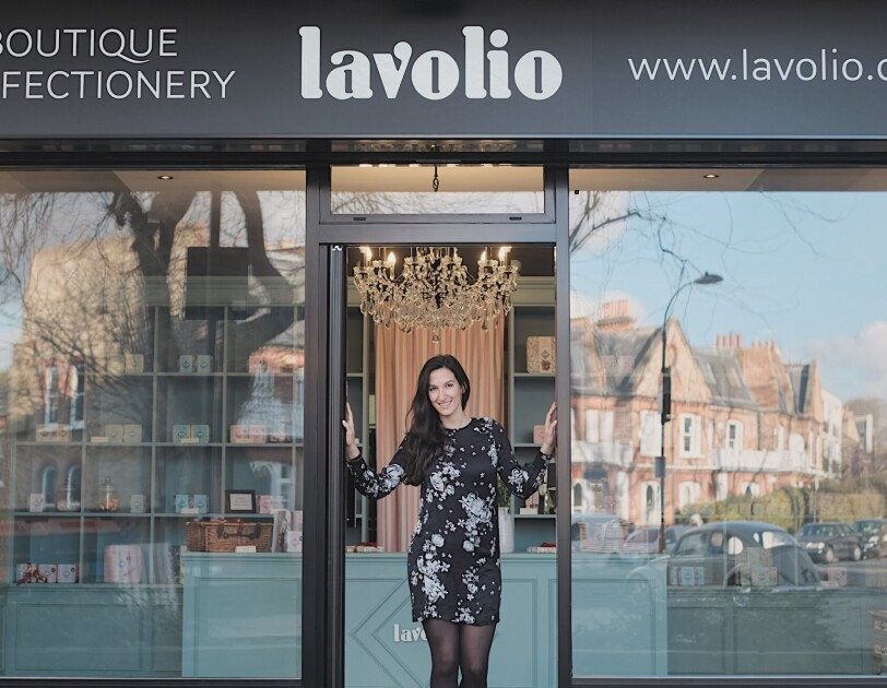 Lavina business owner stood outside shop front