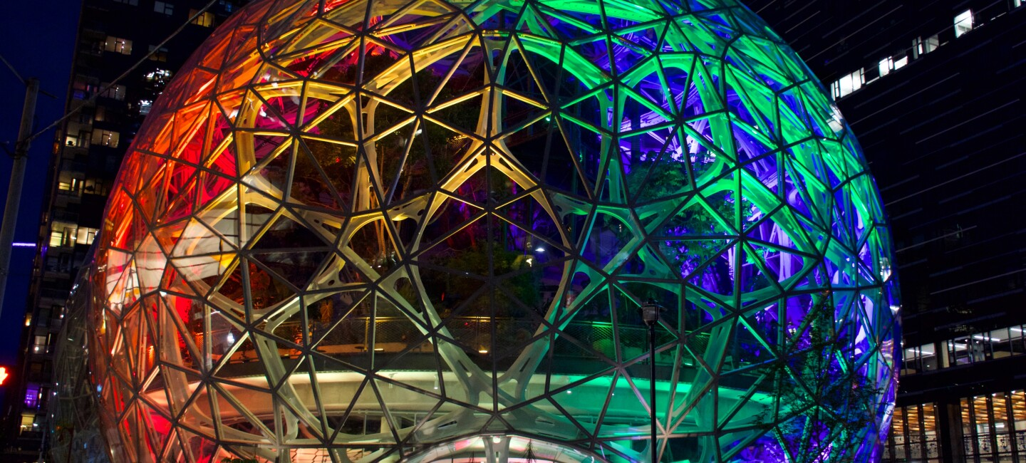 The Seattle Spheres at Amazon HQ in Seattle, WA lit up in rainbow colors to mark LGBTQ Pride month in June.