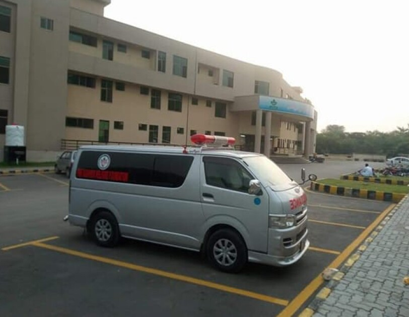 Junaid Hussain's ambulance in a parking lot.