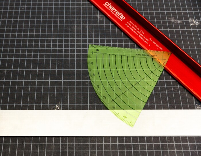 Drafting tools on a graduated cutting mat.