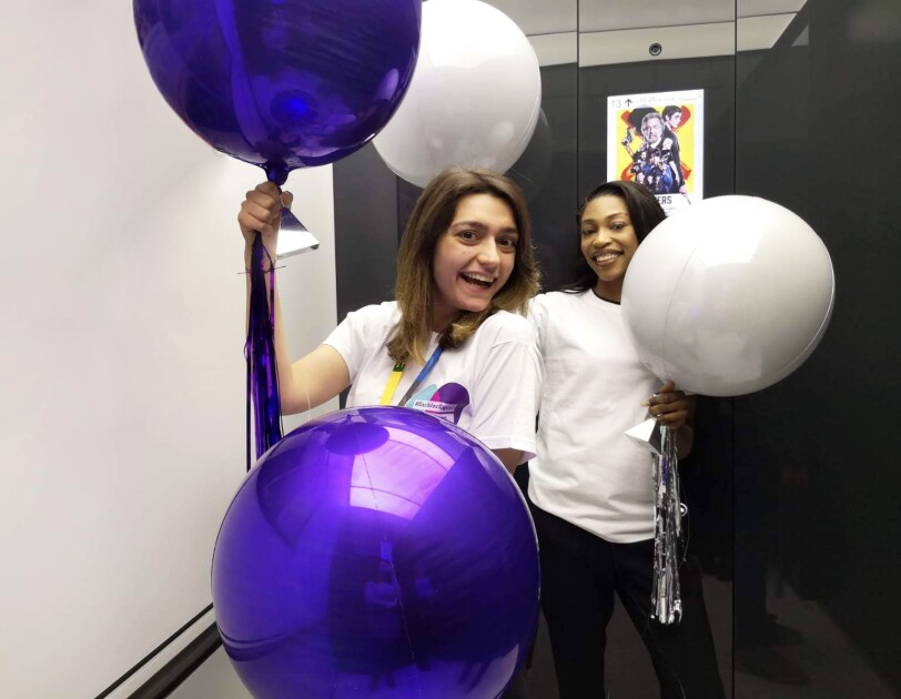 Amazon employees holding balloons for International women's day