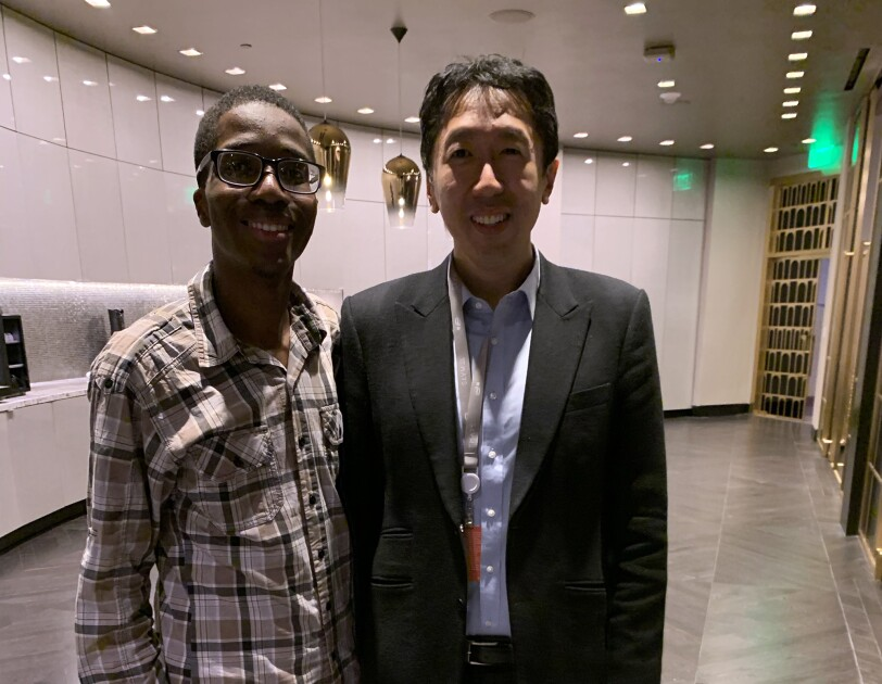 A teen (Leo Jean Baptiste) stands next to Standard professor and re:MARS keynote speaker, Andrew Ng.