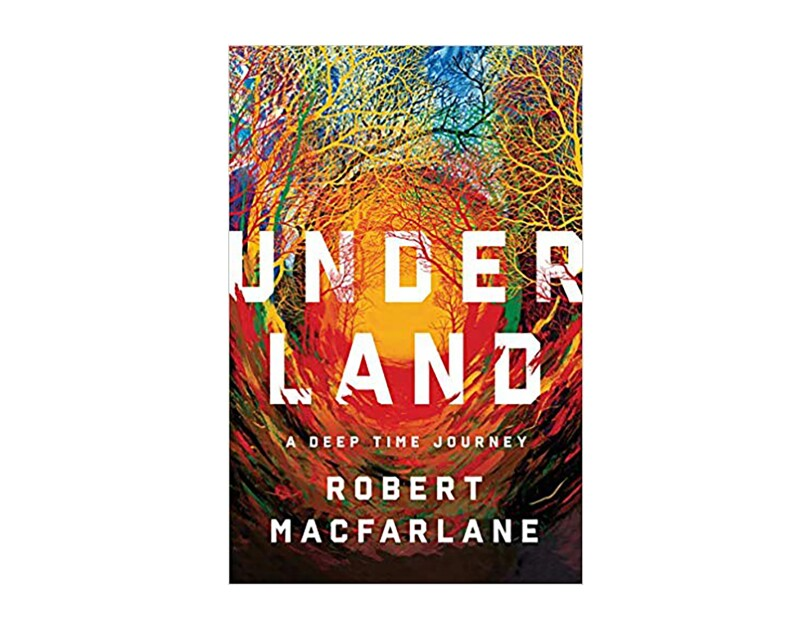 "Book cover for ""Underland"" by Robert Macfarlane, with the title and author name printed in white serif font. The background is a swirl of colors across the spectrum, crawling up into what appears to be tree branches."