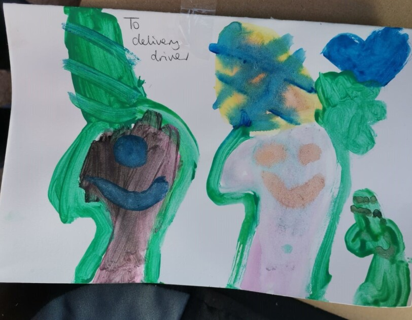 A colourful child's painting for an Amazon delivery driver with a note saying 'to delivery driver'