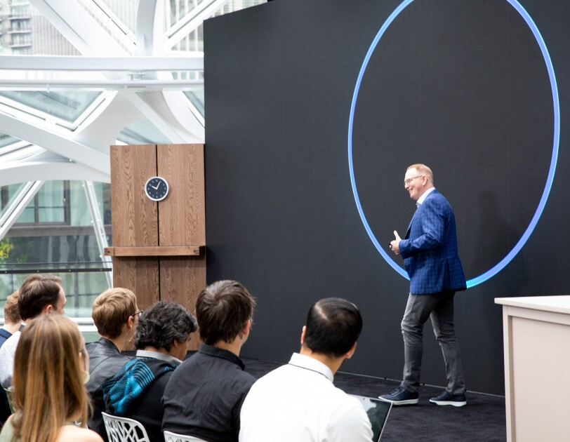Amazon Devices VP David Limp on stage in front of a large image of the top of an Echo