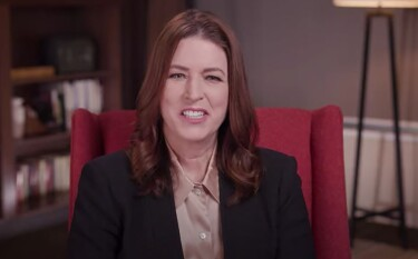Amazon Sustainability Vice President Kara Hurst sits in an office setting in a red wingback chair.