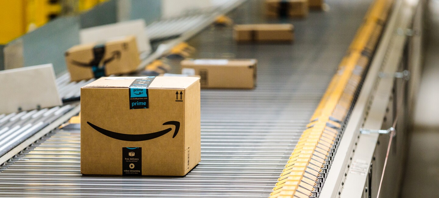 Amazon delivery boxes roll down a conveyor belt at Amazon's warehouse in Baltimore, Maryland.