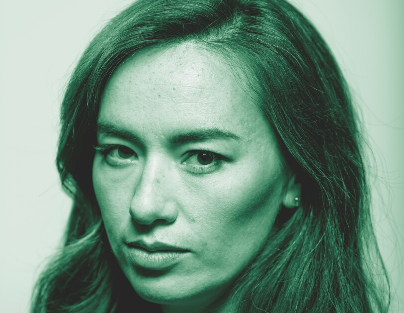 """Cara Gee, from the Amazon Originals series """"The Expanse"""" poses for a photo. The image has been treated with a green filter."""