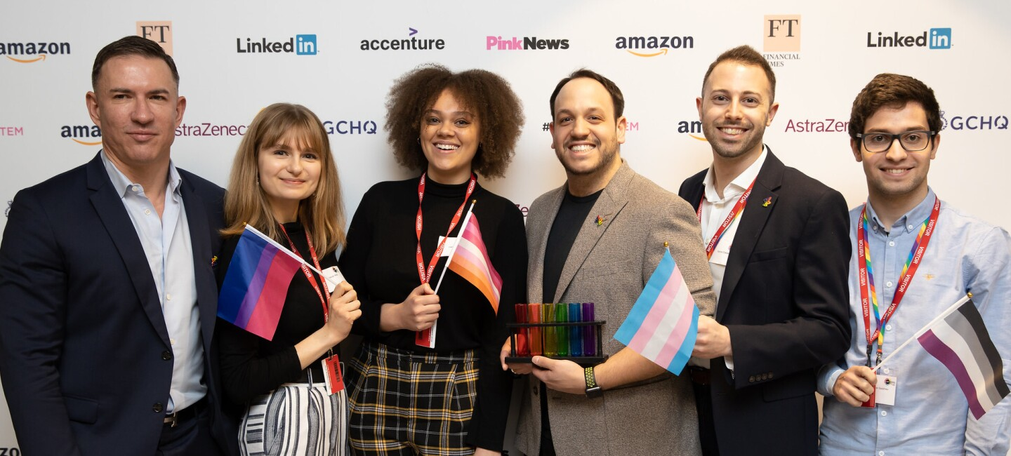 STEM leaders from Amazon at the 2020 British LGBT+ Awards, they are holding flags which are representative of the various LGBT+ communities.
