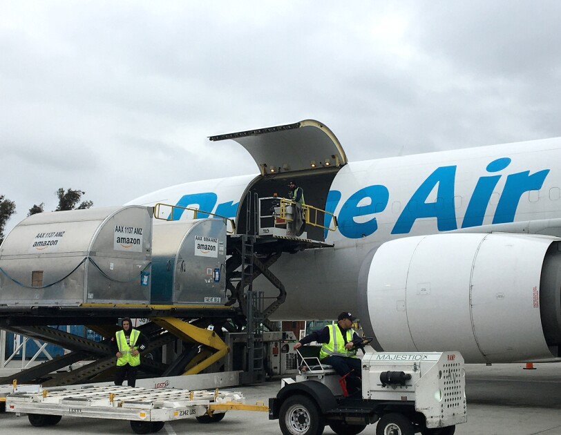 Ground crews load an Amazon Air cargo plane.