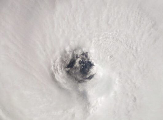 A satellite image of the eye of a hurricane illustrates how ASDI enables critical climate research.