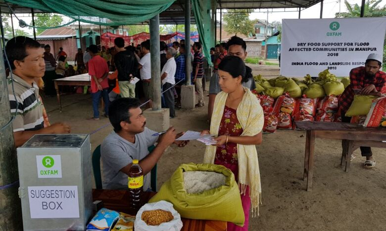 Oxfam Goon help in flood relief by giving away necessary items to the affected
