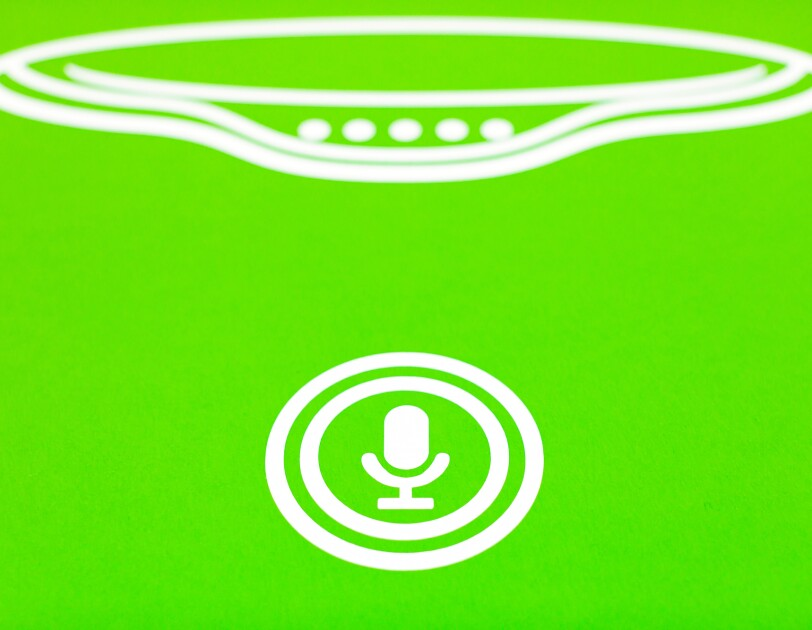 A line drawing of the mute button on an Amazon Echo. The background is green and the line drawing is white.