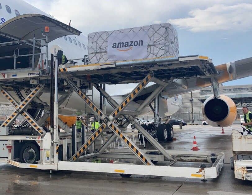 A supply package with the Amazon logo on it being boarded onto a freight plane to be sent to Nepal.