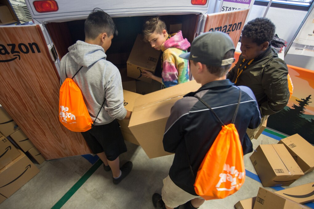 Students participate in a Camp Amazon event at a fulfillment center in Washington