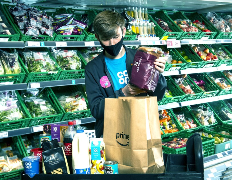 Reece Folan hand picking groceries in co-op, crown street, glasgow for Amazon prime order