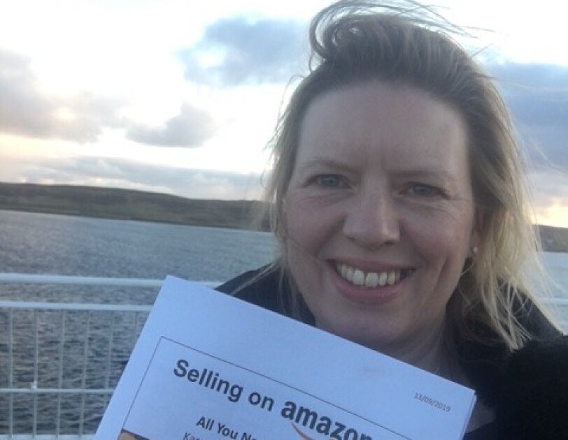 Karen Riddick holding booklet on Selling on Amazon