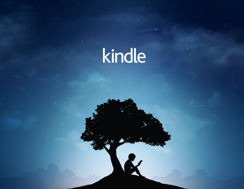 Amazon's Kindle Reader Tree brand image: a boy sits under a tree reading a book.