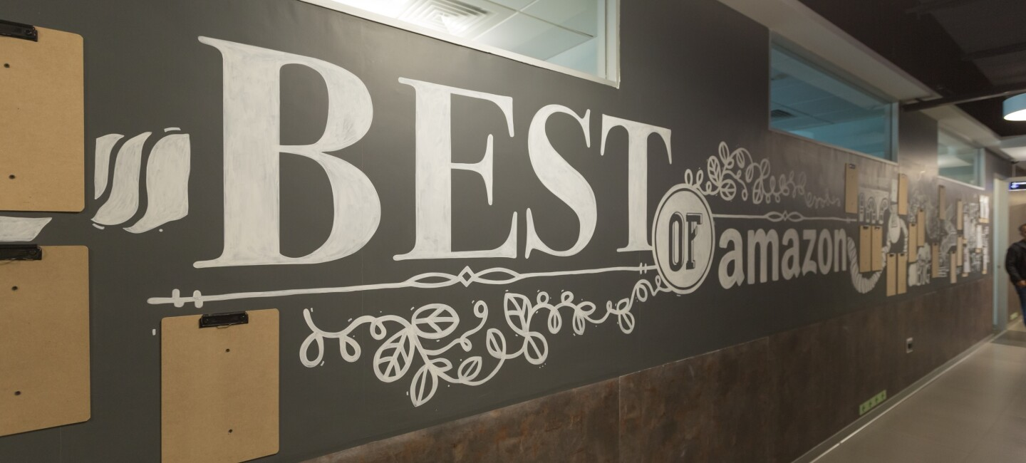 "The walls in an Amazon building that is painted with the words ""best of Amazon"""
