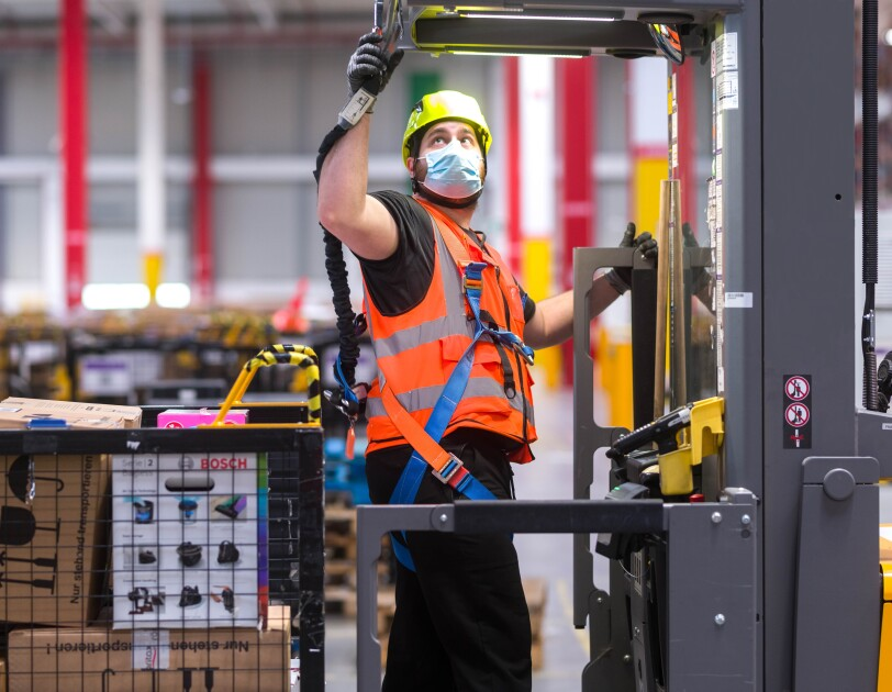 Amazon employee using a height safety harness