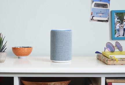 Alexa device sat on top of white desk