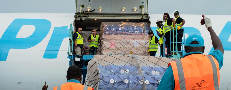Airport crews unloading cargo.