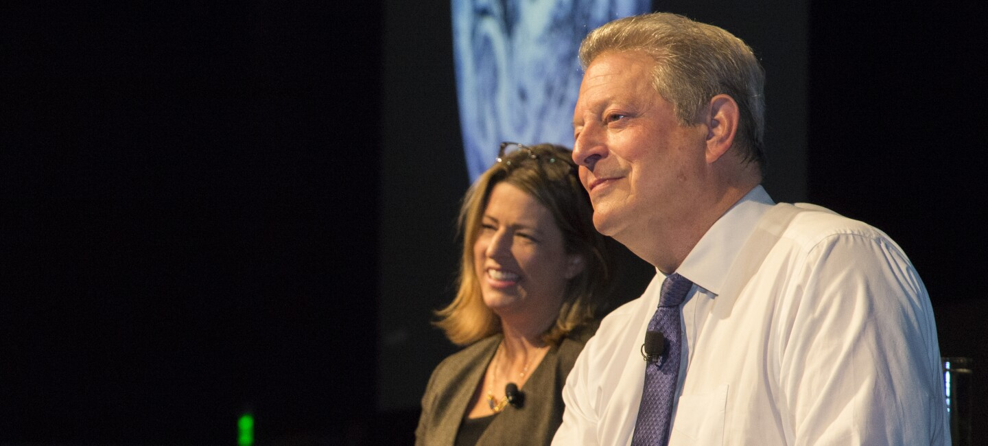 Amazon Director of Sustainability Kara Hurst (L) and Vice President Al Gore on stage at Amazon