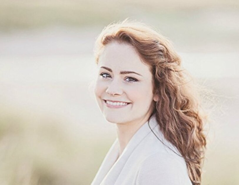 A portrait of Louise Ross smiling at the camera