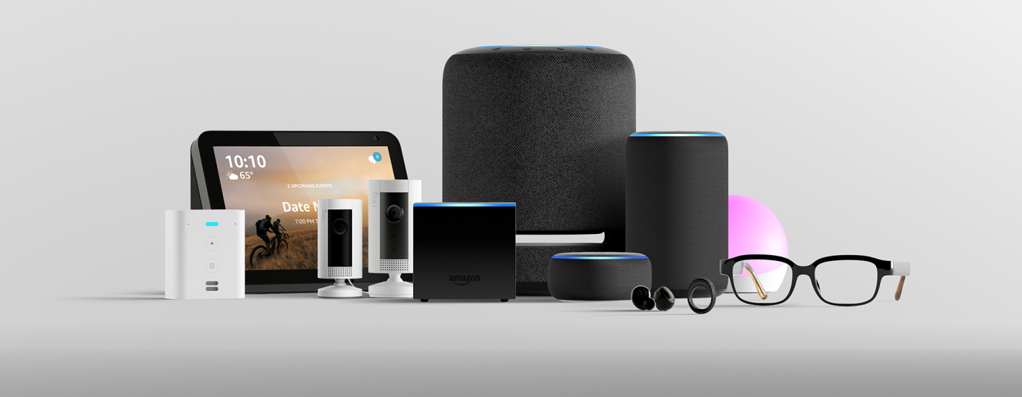 Amazon devices gathered together, in front of a gray background.