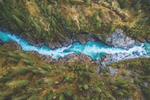 Aerial Vertical View Over The Surface Of A Mountain River Glomaga