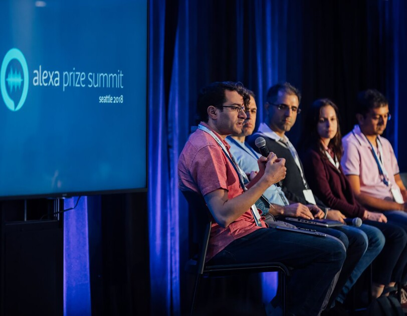 Amazon scientists, who make Alexa magic happen, speaking during a panel discussion.