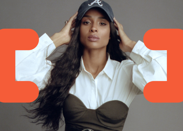 Singer/songwriter, Ciara, poses while coding symbols are overlaying the image.