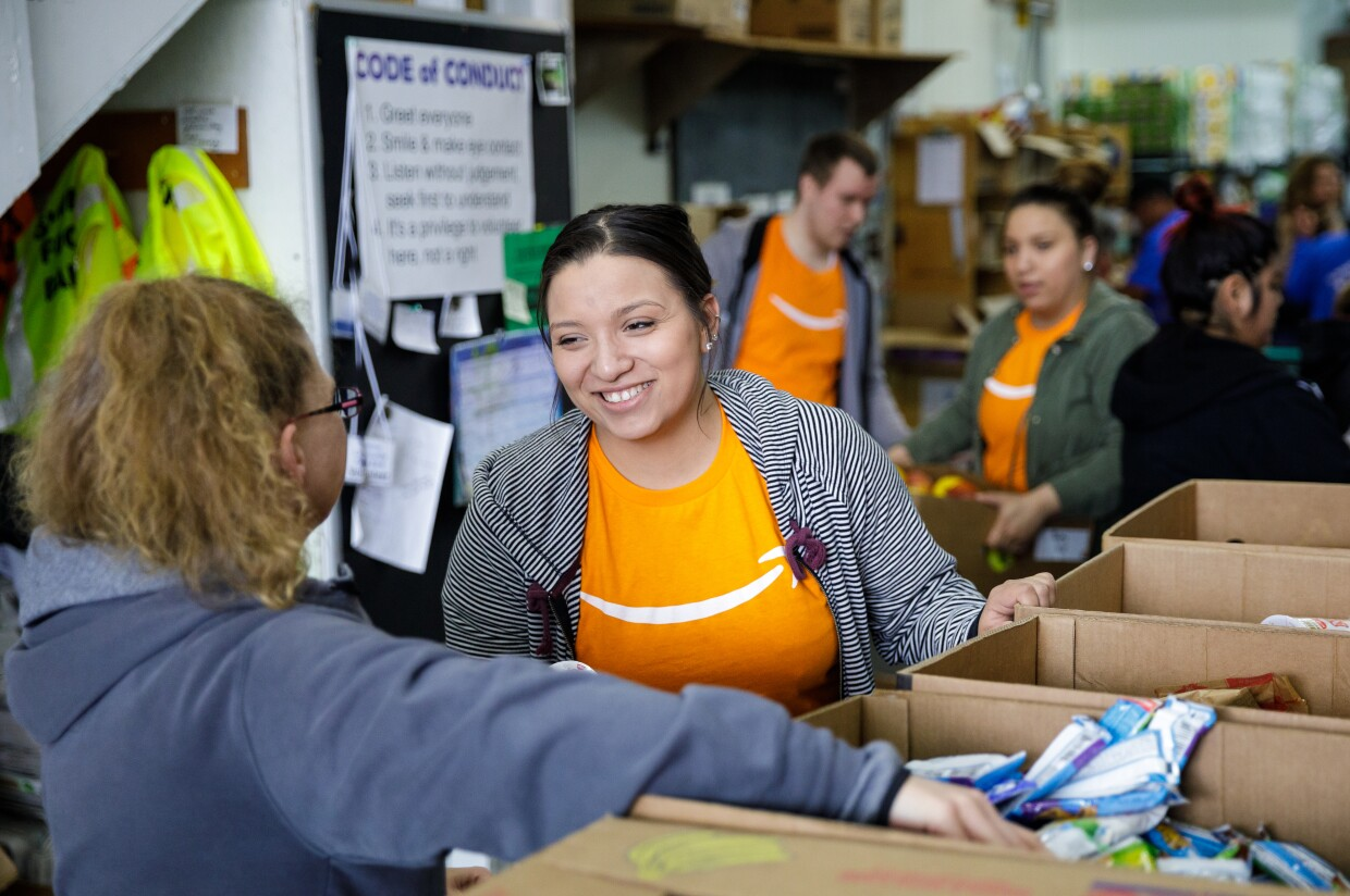 Amazon employees volunteer at a community food bank in the Puget Sound region of Washington state.