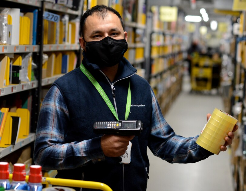 Junaid Hussain scanning items in a Fulfilment Centre in Peterborough.